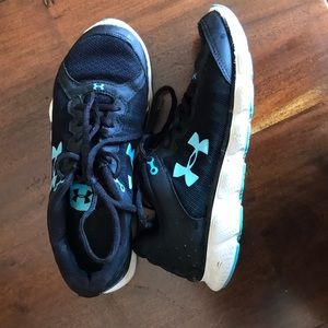 Under Armour assert 6 tennis shoes black and teal.